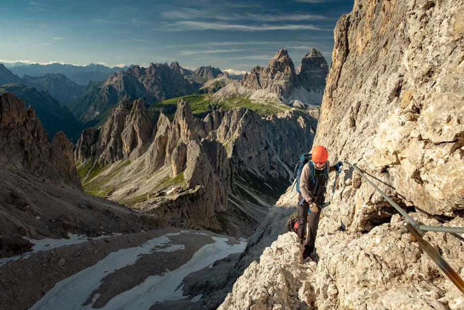 A climber on the via ferrata Merlone in the Italian Dolomites