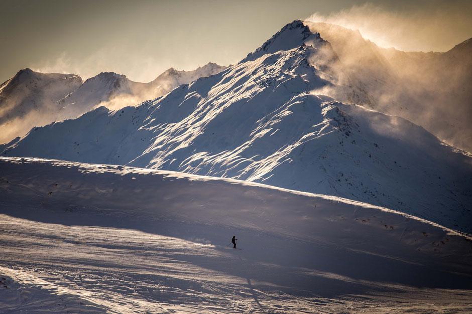 Lone skier on the Treble Cone ski area near Wanaka, New Zealand.