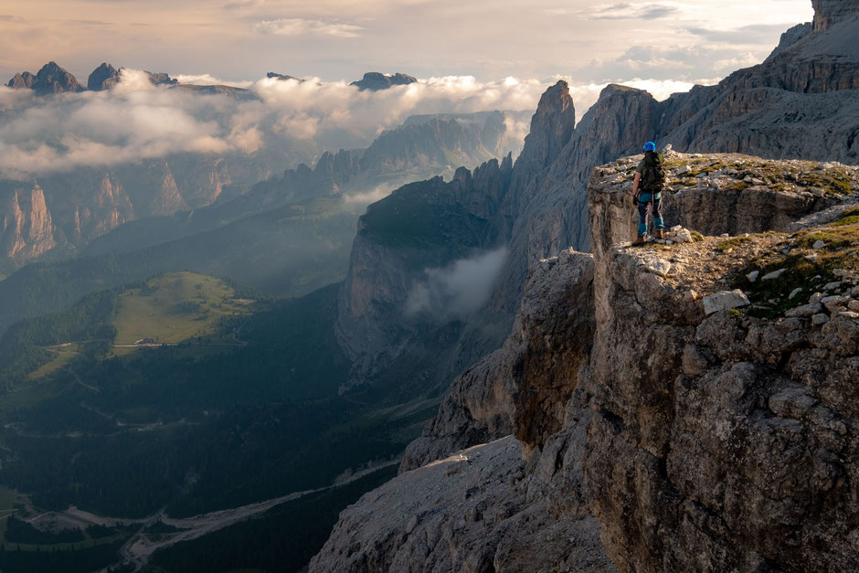 Climber along the via ferrata Pössnecker in the Italian Dolomites