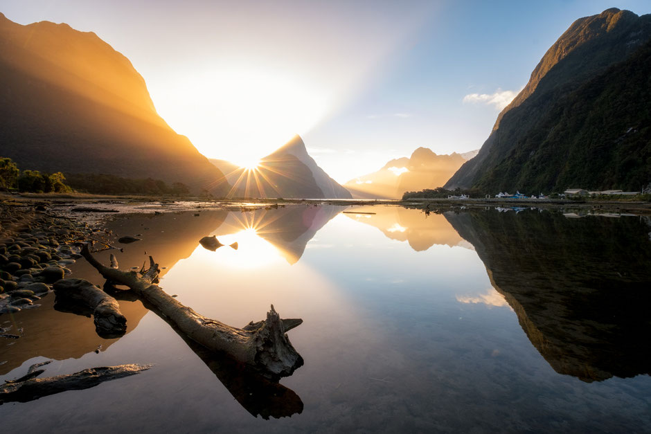 Sunset and sun beams over Mitre Peak in Milford Sound in New Zealand. A must visit spot on the two week self drive itinerary designed for hikers and photographers
