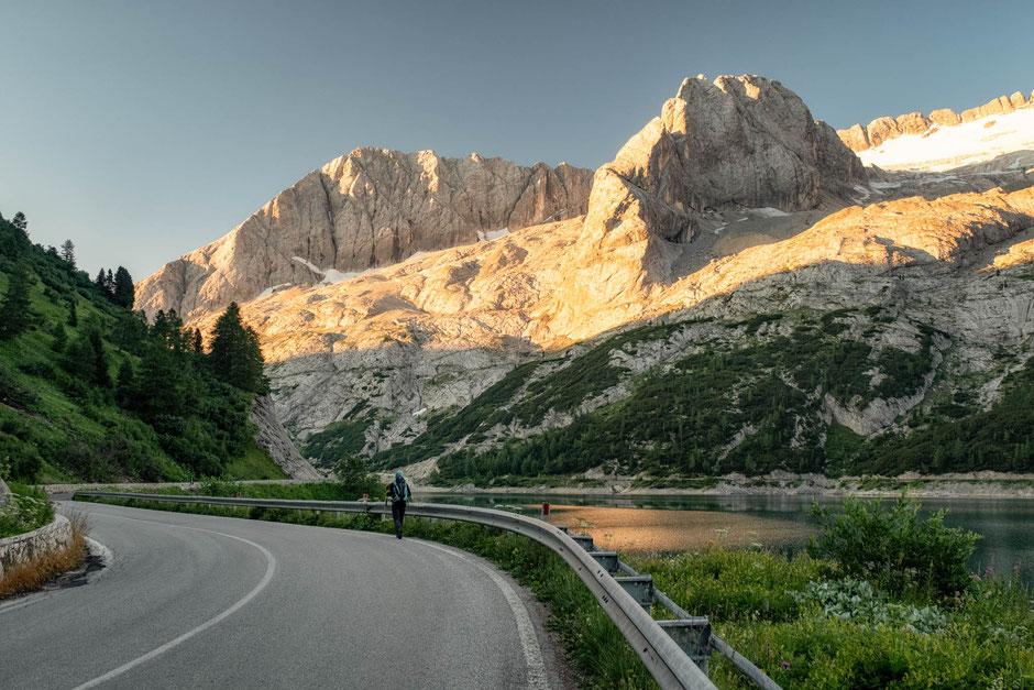 Hiking along the road from Passo Fedaia to Malga Ciapella with Marmolada - Dolomite's highest peak, straight ahead. Day 6 of Alta Via 2.