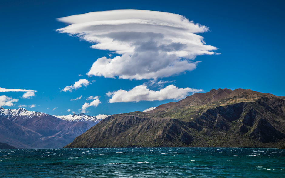 Lake Wanaka and lenticular clouds above it