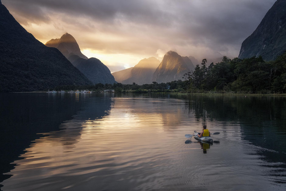 Kayaking in Milford Sound at sunset.