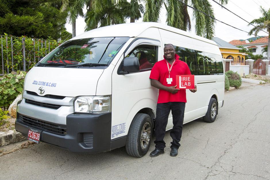 Derrick Ricketts, IRIELAB guest guide standing near Toyota van in Jamaica