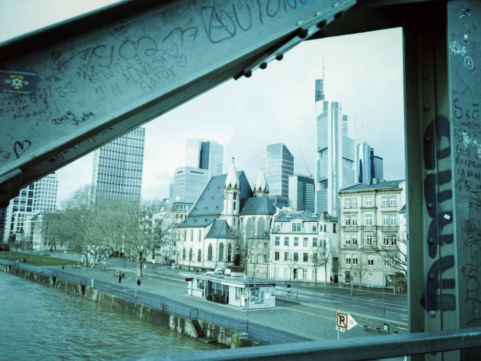 Skyline of Frankfurt am Main framed view through the bridge construction.