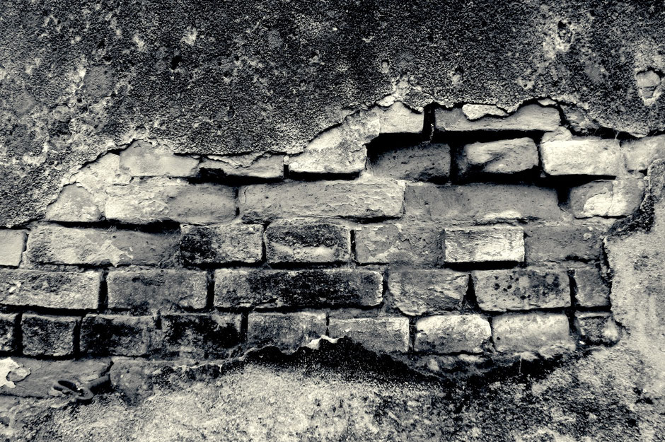 Black and white photo of an old wall