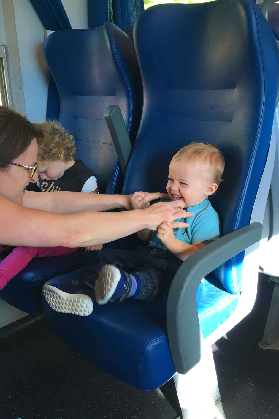 Keeping toddlers entertained on the train - Piombino to Livorno, Italy