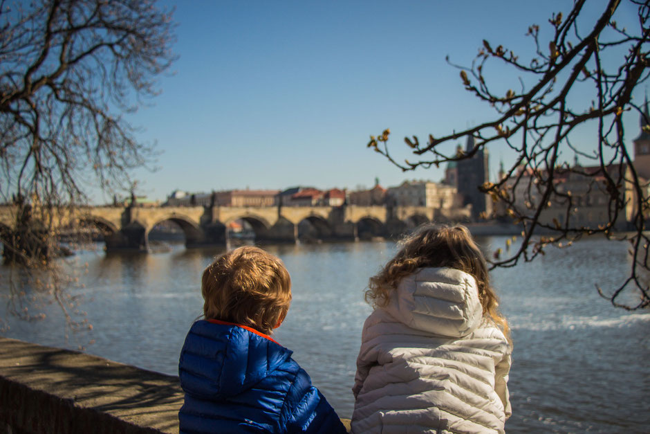 View of Charles Bridge from Kampa island with Kids in Prague