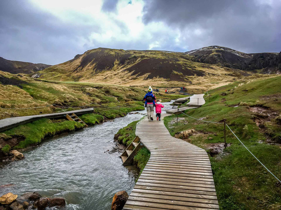 Walking the boardwalks along the Hveragerði Hot Springs River Trail in Iceland with kids