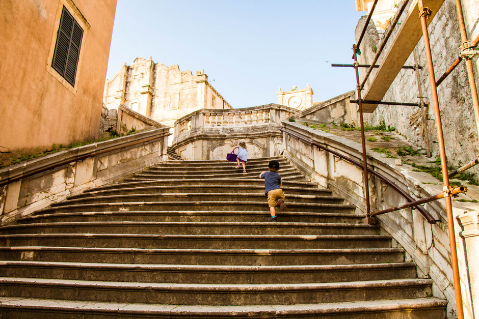 Climbing the stairs to St. Ignatius Church in Dubrovnik Croatia with children