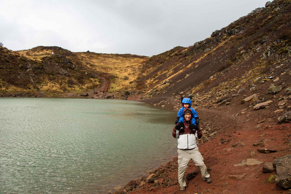 Walking the Kerid Crater lake in the Golden Circle Iceland with a toddler