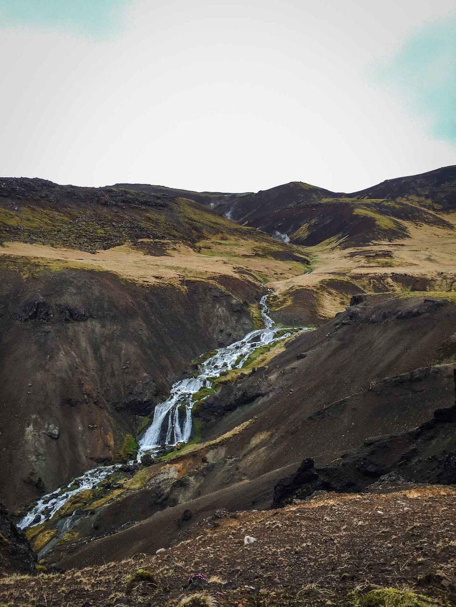 Waterfall along Hveragerði Hot Springs River Trail in Iceland