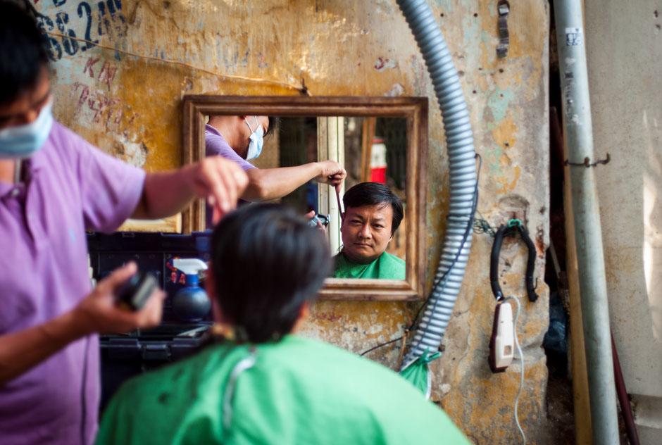 Street barber in Hanoi, Vietnam, 2016