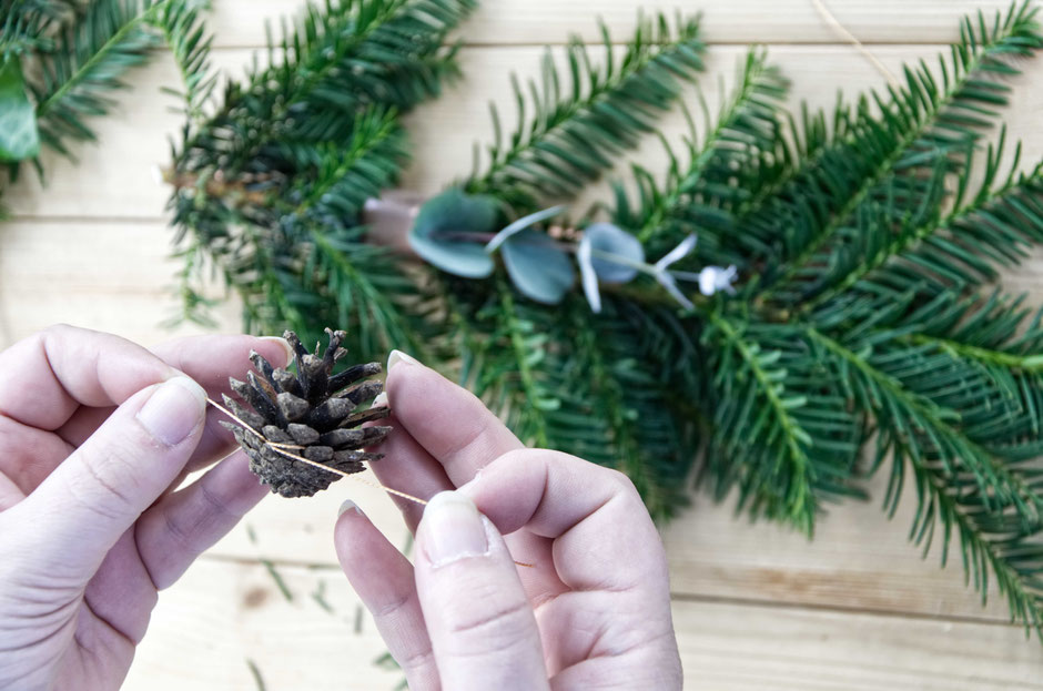 Geometric Winter wreath DIY and tutorial on how to attach pine cones and concrete ornaments