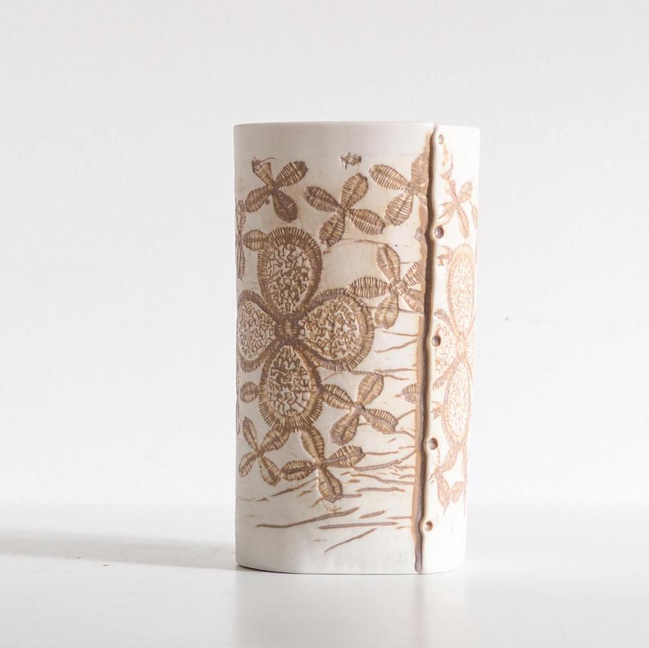 brown and white ceramic porcelain vase