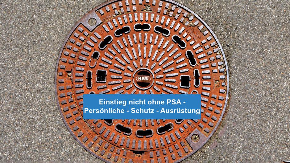 Einstieg in eine Schacht nicht ohne PSA - Persönliche - Schutz - Ausrüstung