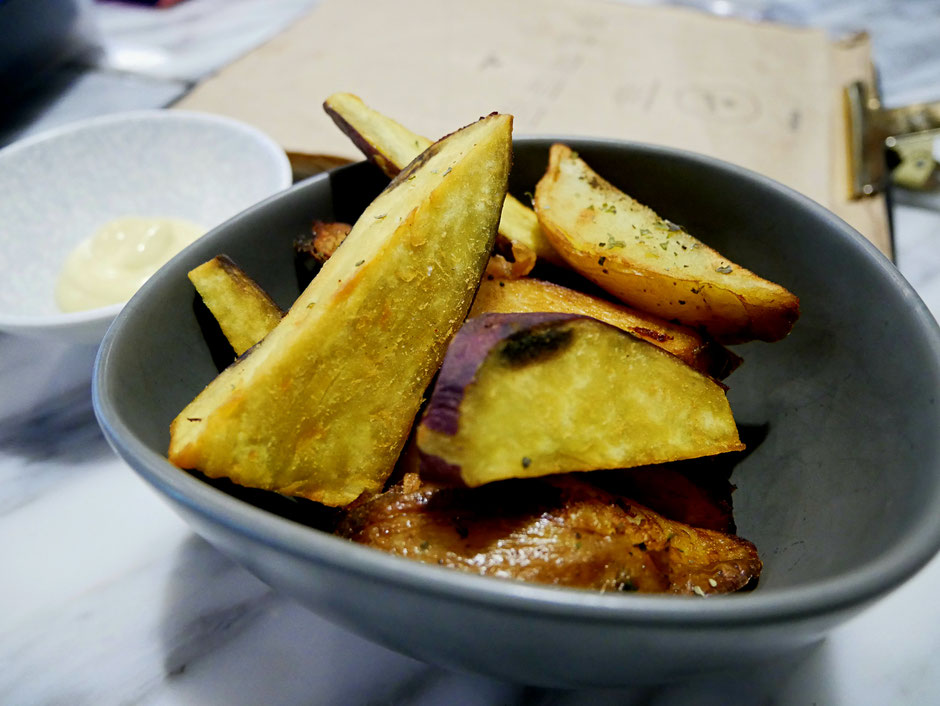 Fried organic potato and sweet potato wedges seasoned with sonnentor herbs, salt and pepper at Real Food Cafe Orchard Central
