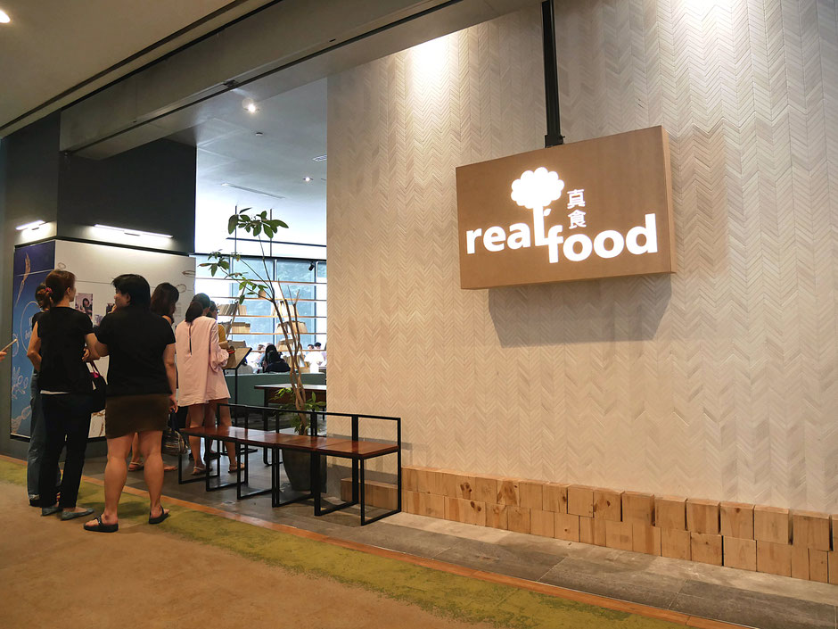 People queuing up at the entrance of Real Food Cafe Orchard Central on Friday lunchtime