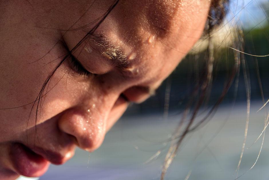 Asian woman perspiring profusely