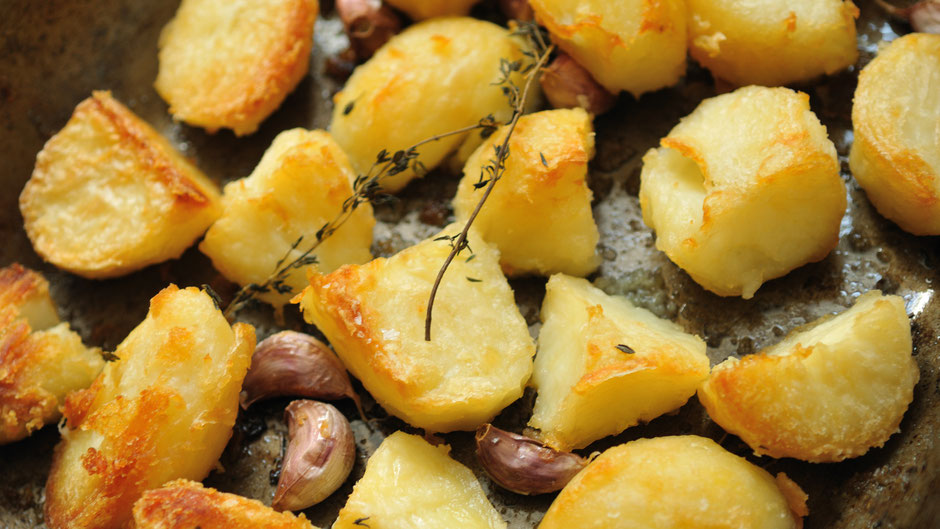 roasted potatoes and garlic on a baking tray