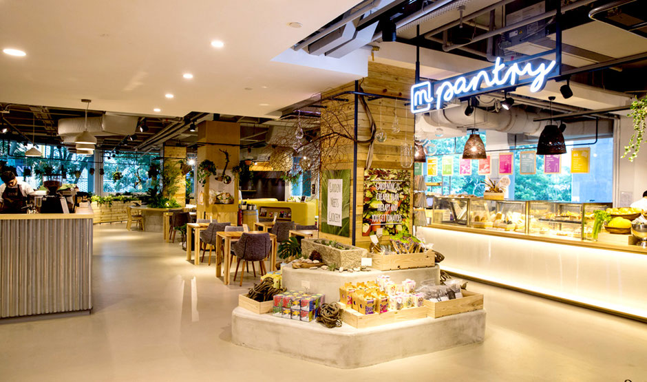 Interior of Mahota Pantry with bright, airy and featuring lots of light wood and plants