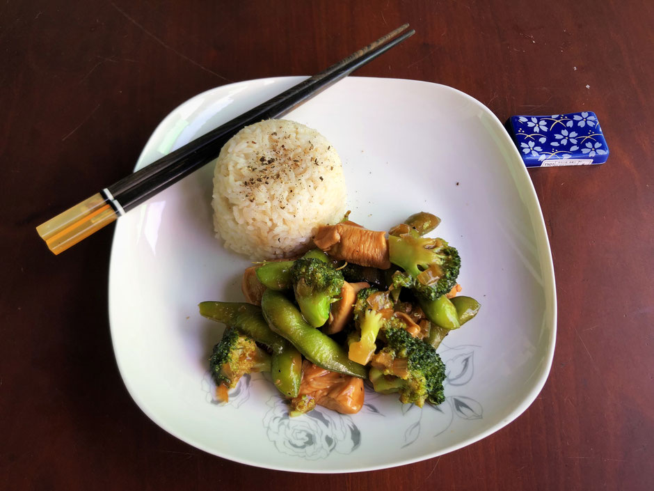 Plate of Chinese chicken and vegetable stir-fry served with activated brown rice
