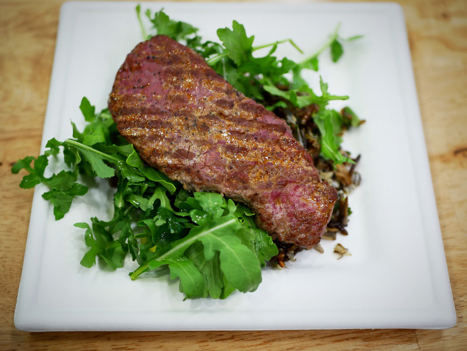 Wild rice salad with broccolini, mushrooms, arugula, and a lean strip steak at SuperNature Cafe