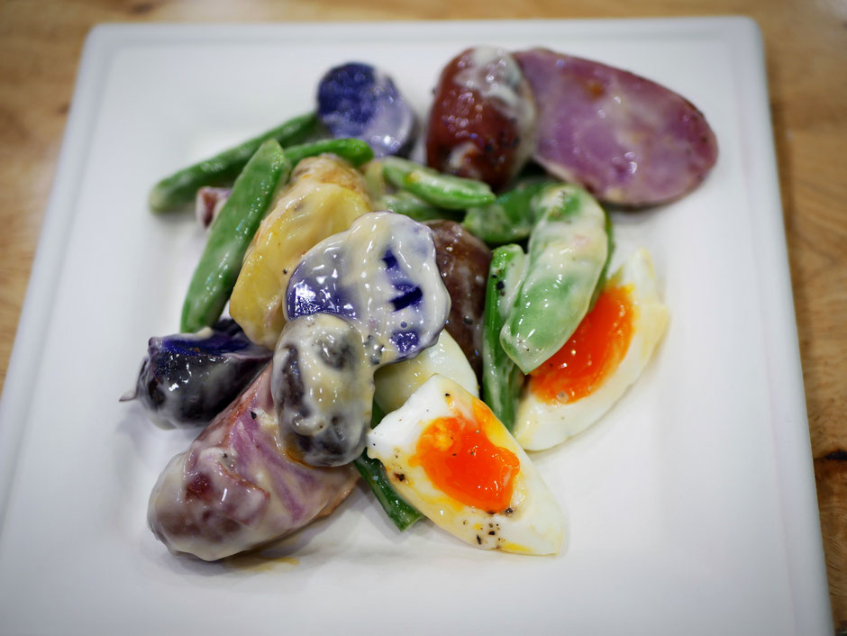Rainbow potato salad with sugar snap peas and organic feed eggs dressed with mayonnaise at SuperNature Cafe