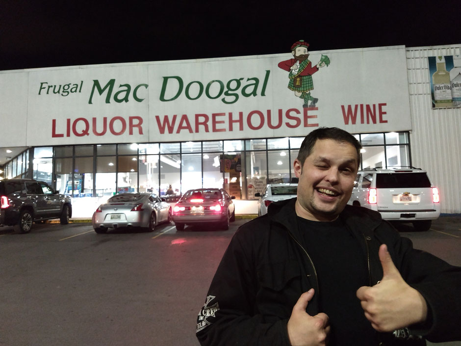Frugal Mac Doogal Liquor Warehouse Phil Vanderkill cars parking lot thumbs up grin wink