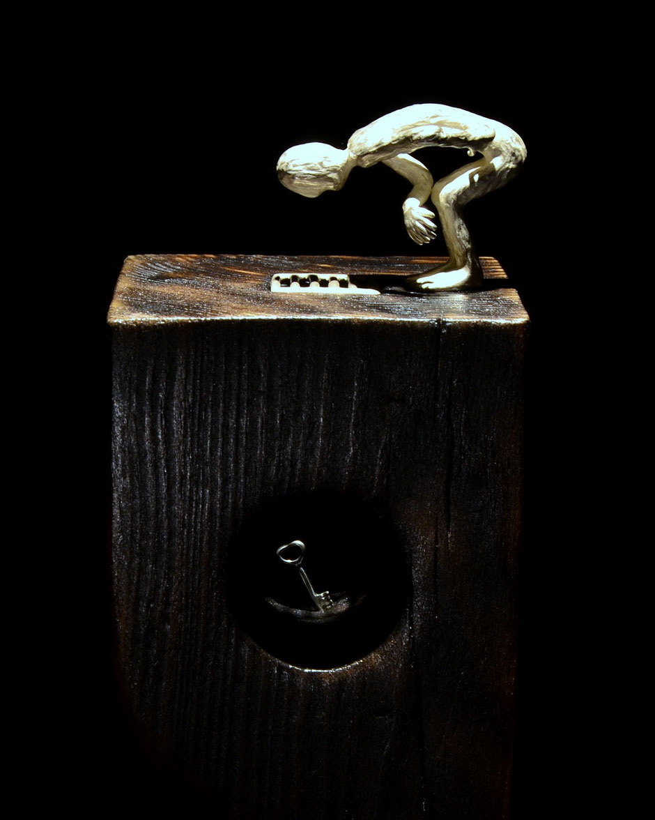 silver sculpture the key by Holger Schulz Småland Sweden silver and wooden pillar