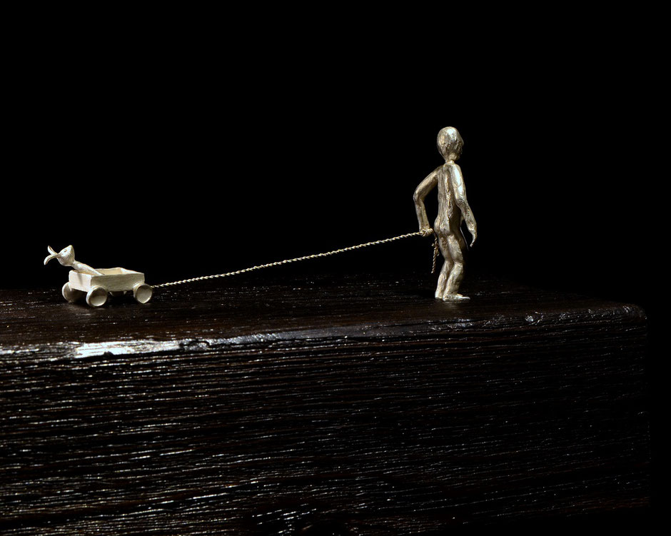 silver sculpture a child's adventure by Holger Schulz Småland Sweden silver and wood