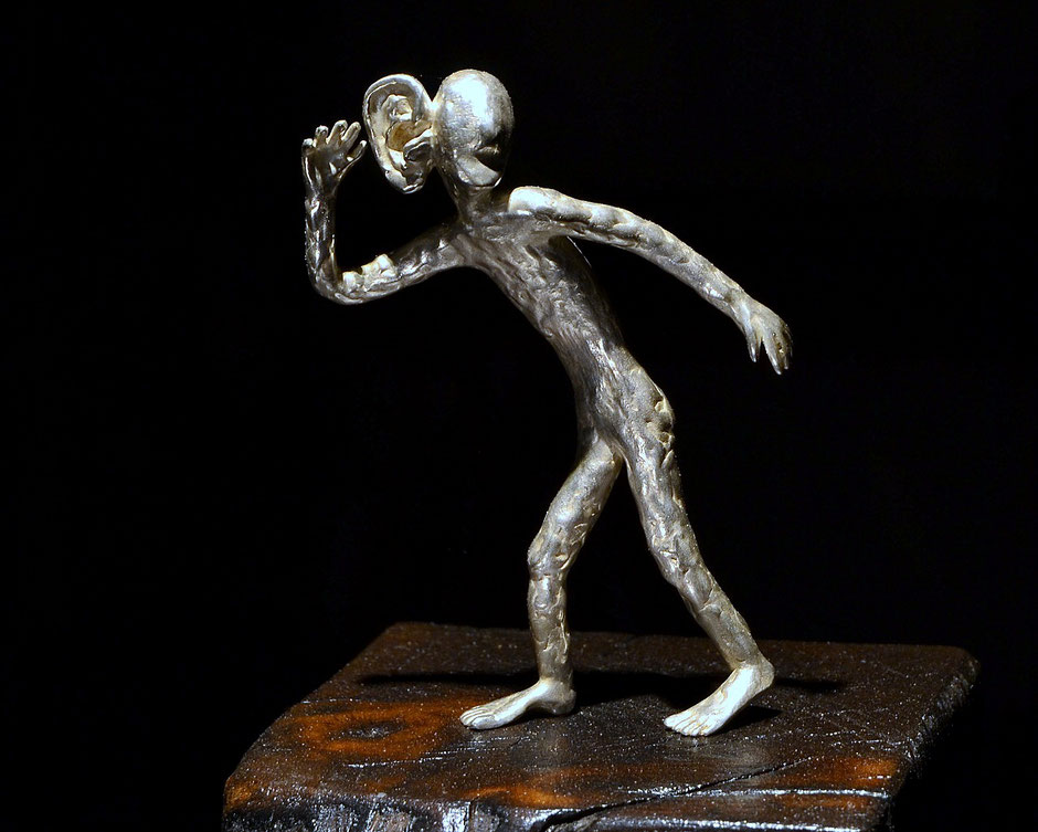 silver sculpture what did you say? by Holger Schulz Småland Sweden silver and wood