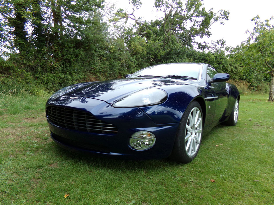 Blue Aston Martin Vanquish S after a full body respray, carried out by Parecision Paint, Wellington