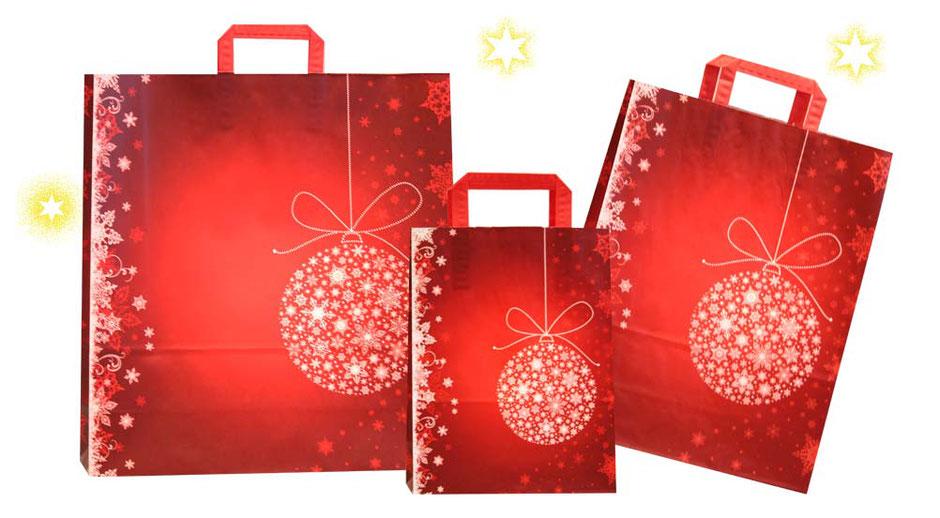 Weihnachtstüte Christbaumkugel in rot mit Sternen und Schneeflocken bedruckt ausgestattet mit rotem Papiergriff elegante Weihnachtstaschen