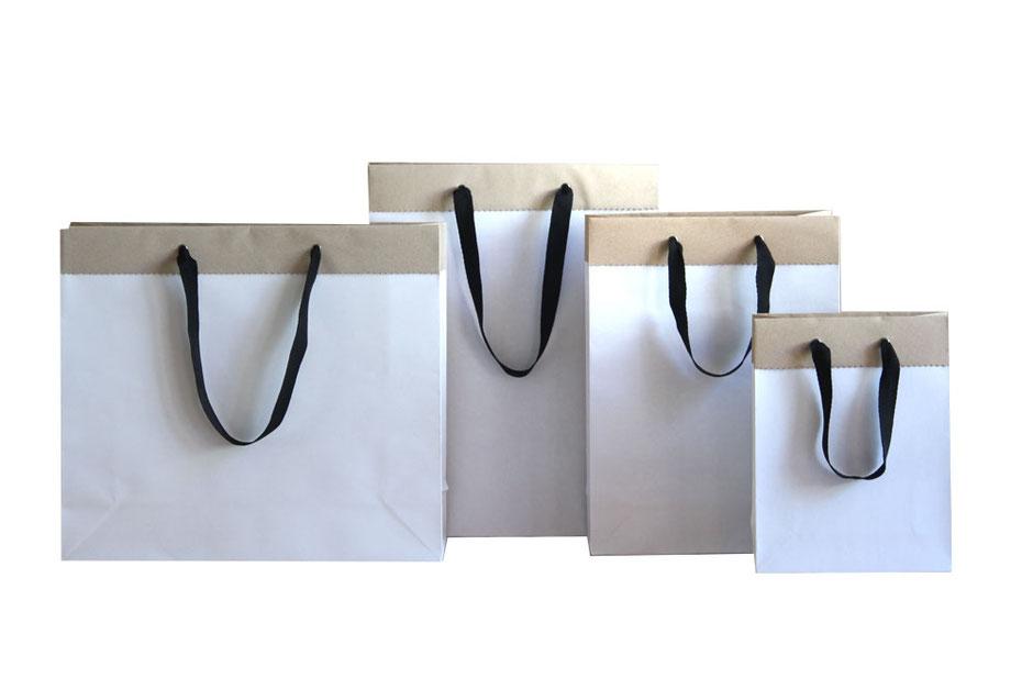 Papiertasche Duplex in weiß mit Umschlag in braun Ösen gold und Baumwollband in schwarz aus Recyclingpapier