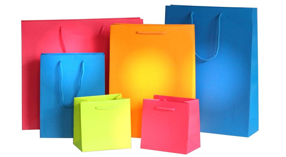 PapierTragetaschen Spirit mit geknoteten Kordeln Kordeltaschen blau grün-gelb Pink und Orange mit Baumwollkordel in Taschenfarbe als Verstärkung Randumschlag und Taschenboden kartonversärkt