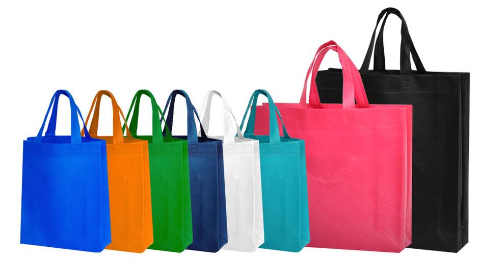 Werbetaschen Bossanova aus PP Non Woven mit farblich passenden Henkel in drei Größen 25x10x30 38x10x40 & 40x12x35cm und acht Farben blau orange grün weiß Pink fuchsia und schwarz für Ihren Werbeauftritt