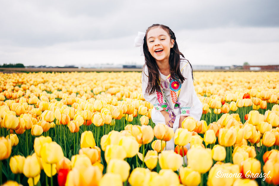 happy girl yellow flower fields