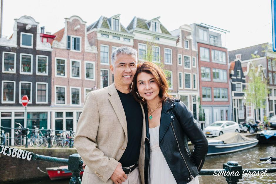 Amsterdam bridge with couple