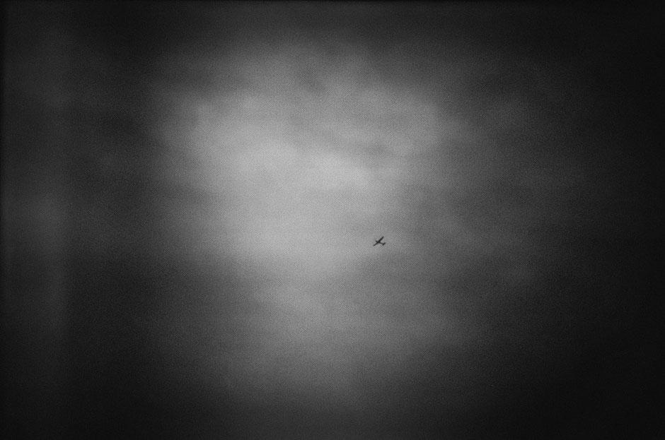LATVIA/ Riga / From the book 'Auftakt'. Small plane in the sky, 02.2005