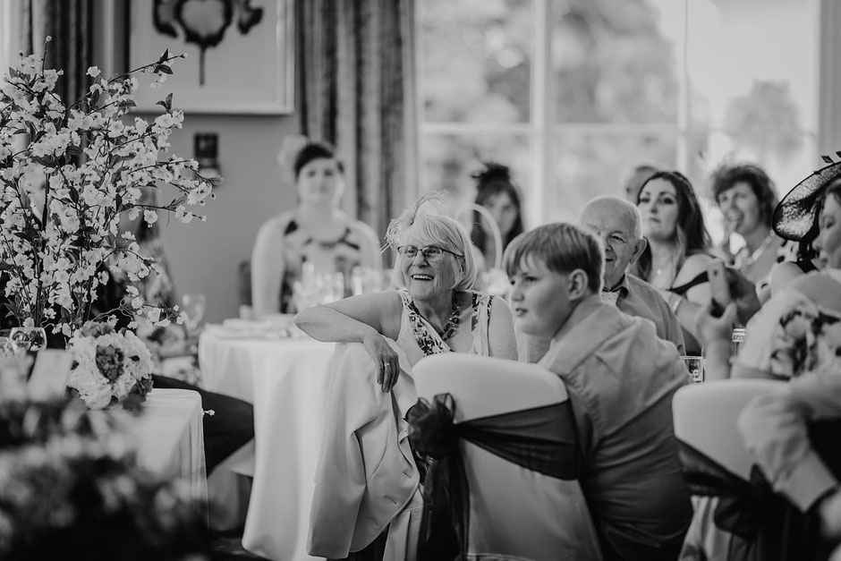 candid photograph of guests watching wedding speeches