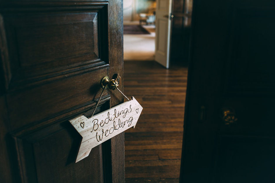wooden sign made by the bride saying beddings wedding