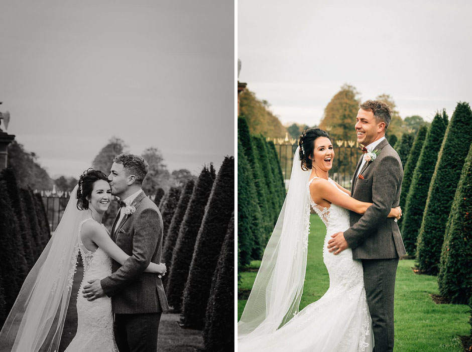 bride and groom posing for photographs in the grounds of Knowsley hall