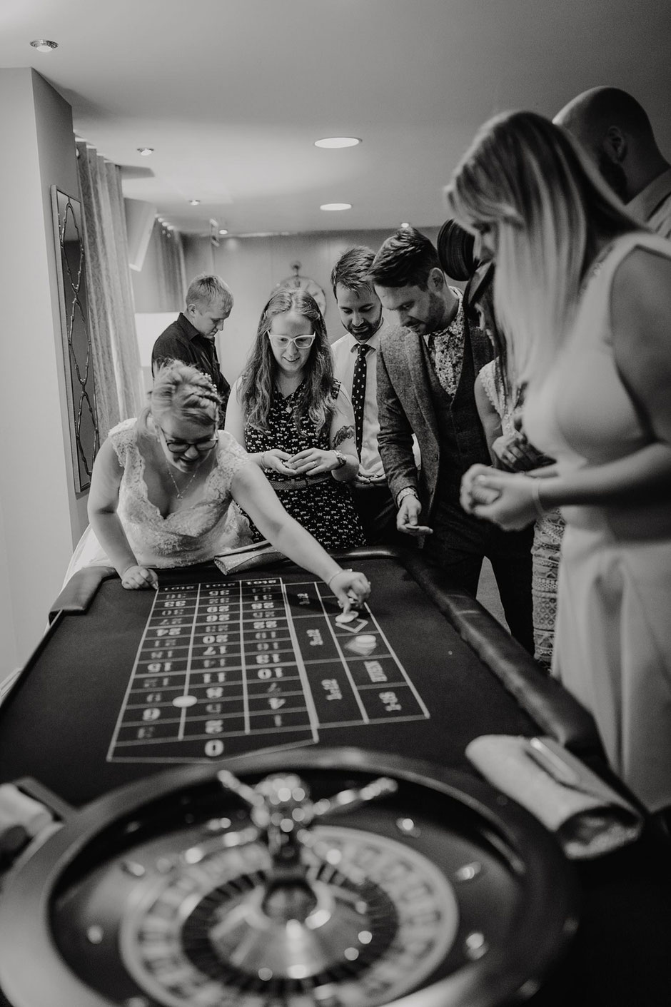 wedding guests surrounding a poker table at ribby hall