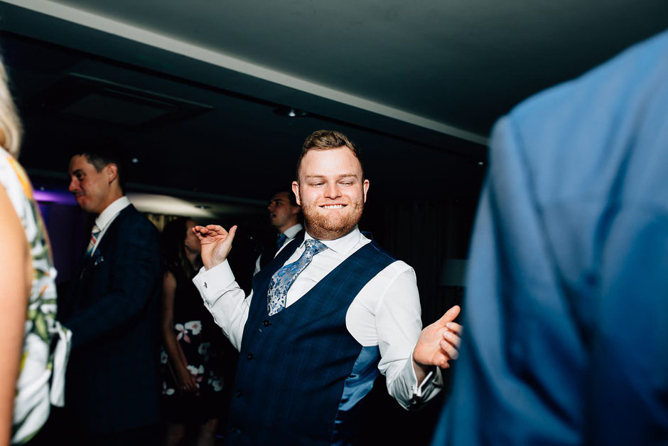 a male wedding guest dancing