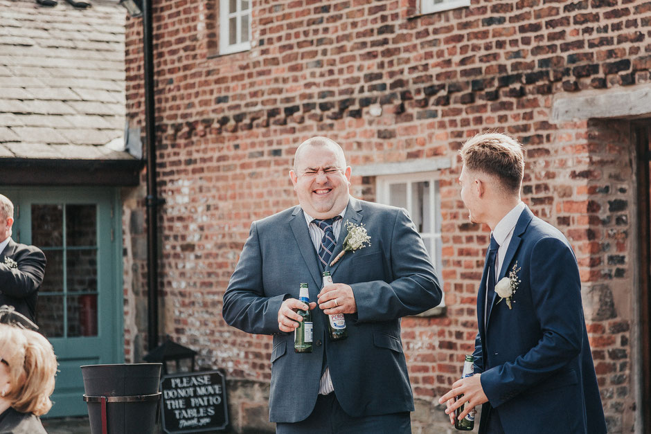 candid shot of a wedding guest at meols hall