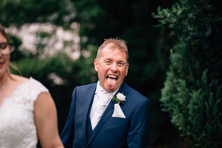 photograph of a man pulling his tongue out towards me