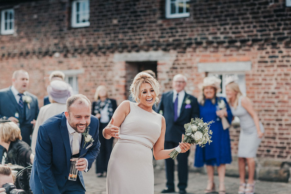 candid shot of wedding guests having fun and laughing