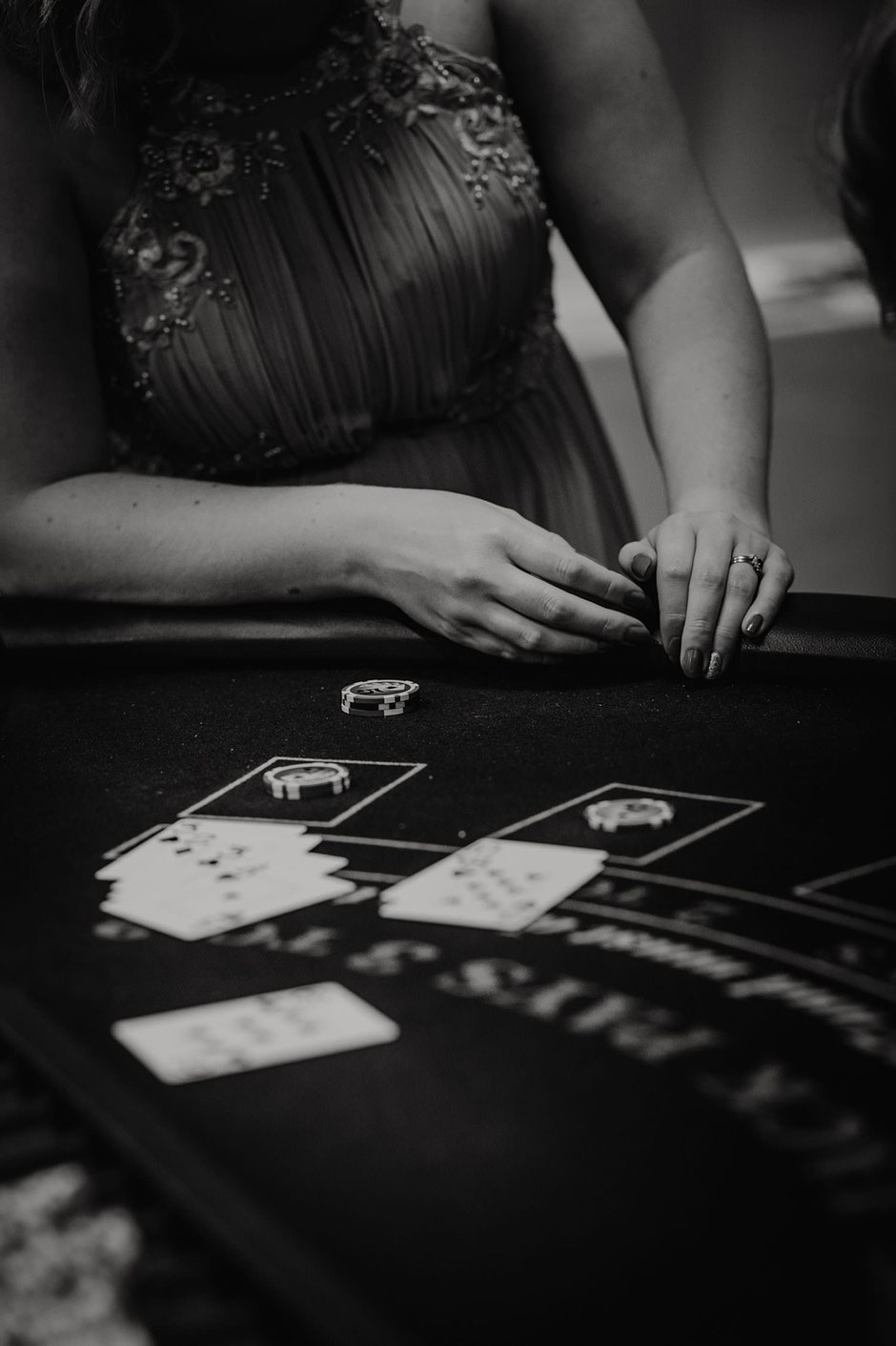 close up black and white photograph of a poker table