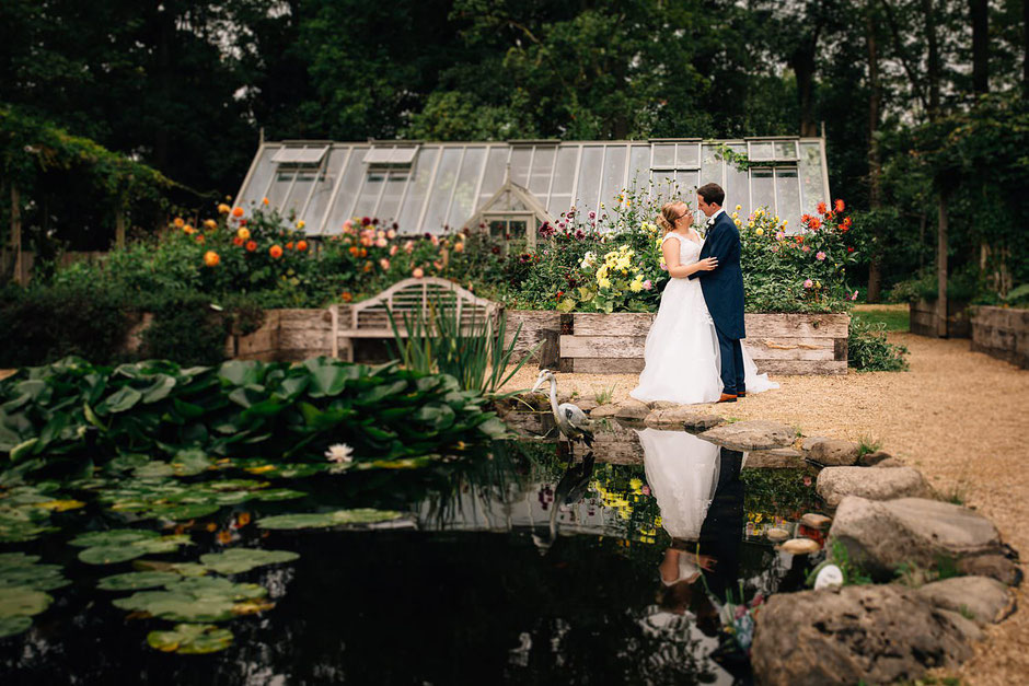 bride and groom in the gardens of ribby hall wedding venue